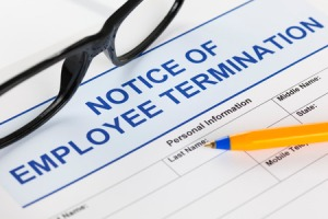 39454888 - notice of employee termination with glasses and ballpoint pen.
