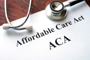 56033703 - words affordable care act  aca written on a paper.