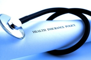 12837750 - stethoscope wrapped around health insurance policies, soft focus