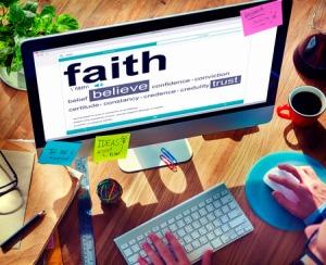 34405947 - man reading the definition of faith