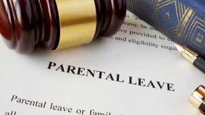 74626995 - page with title parental leave and gavel.
