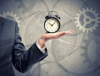 31096470 - concept of time with businessman that hold an alarm clock