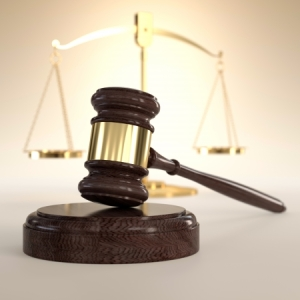 16306823 - 3d illustration of scales of justice and gavel on orange background