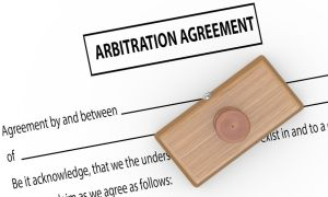 52078340 - 3d illustration of rubber stamp on arbitration agreement