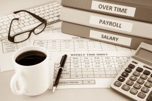 Payroll time sheet for human resources, sepia tone